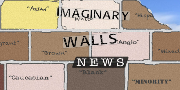 """A brick wall with racialized names on it, such as """"Angle,"""" """"Brown,"""" """"Hispanic"""""""
